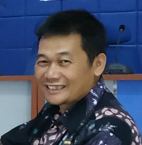Dr. Heru Kuswanto, M.Si